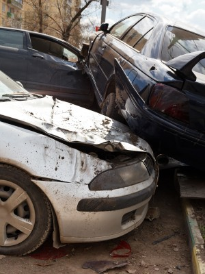three broken cars during road accident on urban street